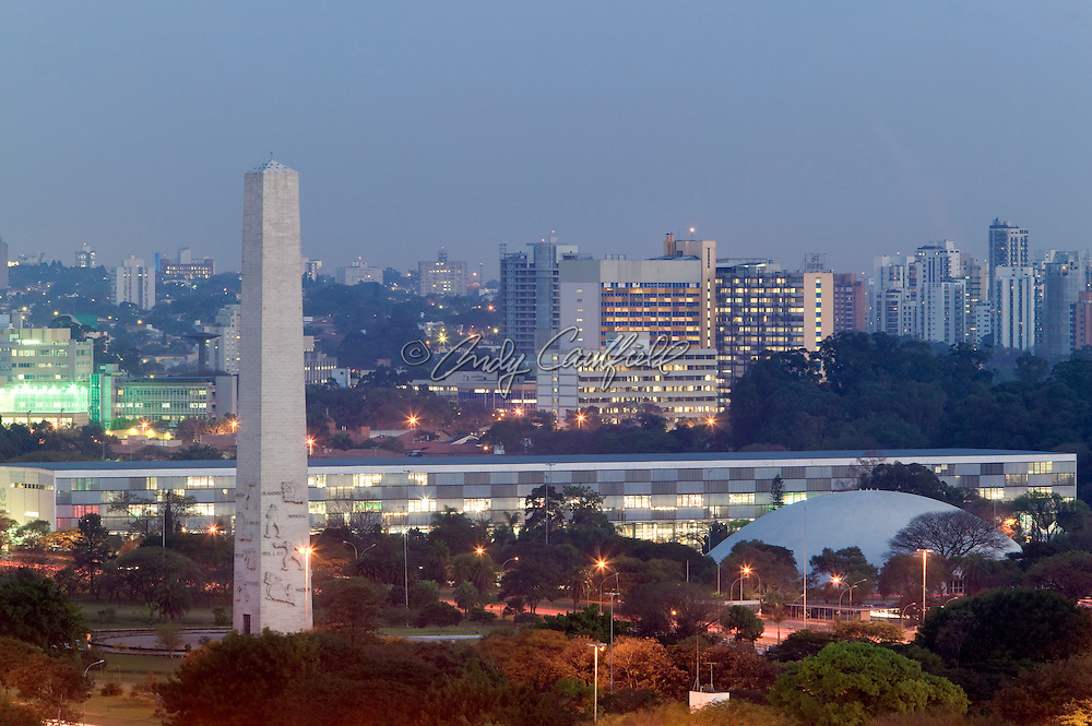 Obelisk, Bienal, Musuem of Art (MAM) in Ibirapuera park at dusk. Moema district in background, Sao Paulo, Brazil.