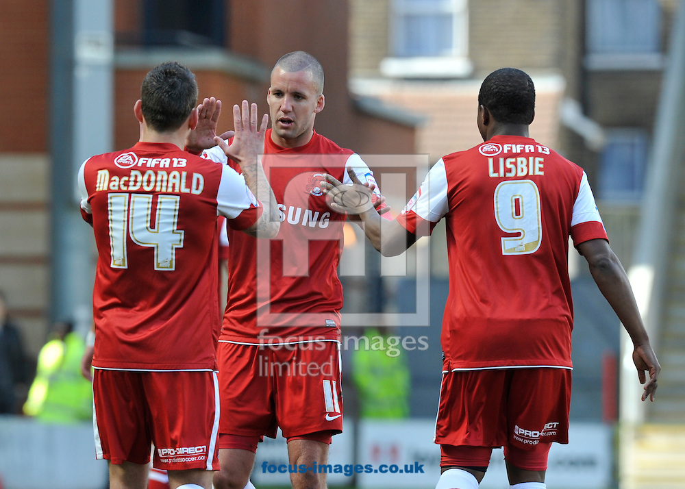 Picture by Alan Stanford/Focus Images Ltd +44 7915 056117.27/04/2013.Jimmy Smith of Leyton Orient celebrates his goal with team mate Charlie MacDonald and Kevin Lisbie during the npower League 1 match at the Matchroom Stadium, London.. .