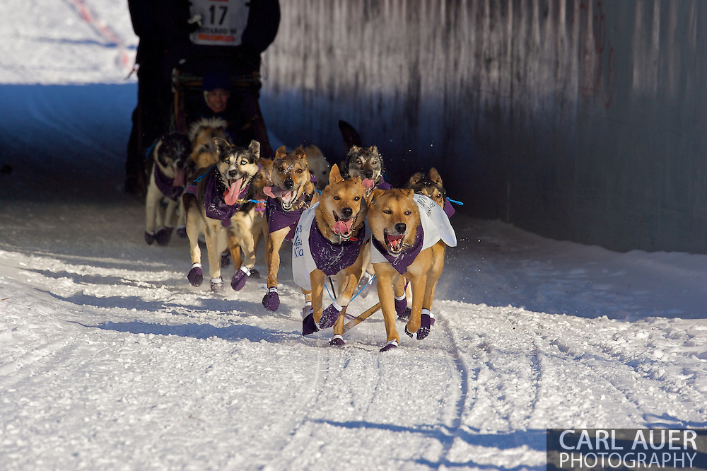 March 7th, 2009:  Anchorage, Alaska - The team of Jessie Royer out of Fairbanks, Alaska comes through a pedestrian tunnel near the Alaska Native Hospital during the Ceremonial Start of the 2009 Iditarod.
