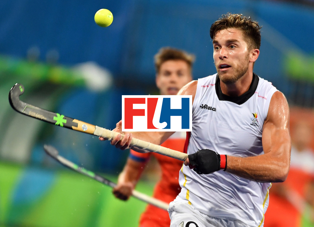 Belgium's Cedric Charlier (R) runs for the ball to score a goal during the men's semifinal field hockey Belgium vs Netherlands match of the Rio 2016 Olympics Games at the Olympic Hockey Centre in Rio de Janeiro on August 16, 2016. / AFP / Pascal GUYOT        (Photo credit should read PASCAL GUYOT/AFP/Getty Images)
