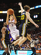 Feb. 15, 2011; Phoenix, AZ, USA; Phoenix Suns guard Goran Dragic (2) puts up a shot against the Utah Jazz forward Gordon Hayward (20) at the US Airways Center. Mandatory Credit: Jennifer Stewart-US PRESSWIRE