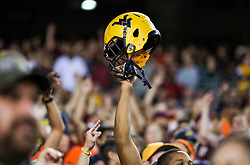 Sep 3, 2017; Landover, MD, USA; A West Virginia Mountaineers fan holds up a helmet during the fourth quarter against the Virginia Tech Hokies at FedEx Field. Mandatory Credit: Ben Queen-USA TODAY Sports