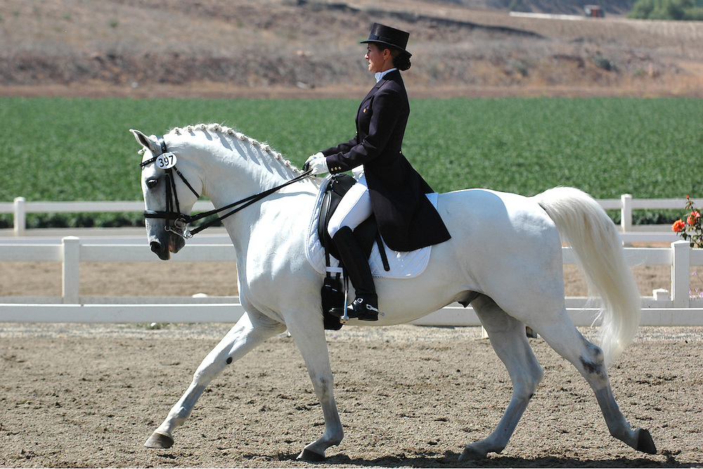 H:\EDITORIAL\Photos\JH 7 July 26 2007 BEAUTIFUL MOVERóDressage rider Mary Burke shows Prince, 9, a white Oldenburg horse in a pre St. George 1st level test during a dressage horse show at Equestrian Performance Center in Moorpark last Saturday. Prince is trained by Tom Valter at Caliente Ranch in Moorpark...