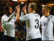 Picture by David Horn/Focus Images Ltd +44 7545 970036<br /> 14/11/2013<br /> Saido Berahino of England Under 21 celebrates scoring his team's second goal with Luke Shaw of England Under 21 and James Ward-Prowse of England Under 21 during the European U21 Championship match at stadium:mk, Milton Keynes.