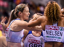 Great Britain's Eilidh Doyle is congratulated by members of the 4x400 relay team after she ran the anchor leg to win silver during day three of the European Indoor Athletics Championships at the Emirates Arena, Glasgow.