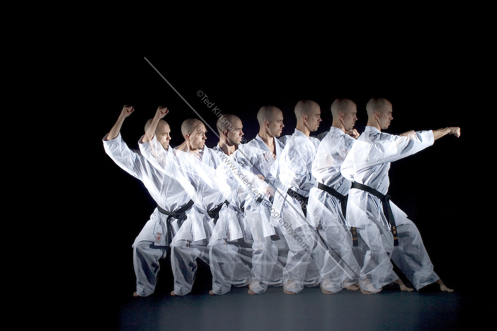 A black belt karate expert performs a punch. A special stroboscopic camera records the motion.  The record of the motion can be analyzed to show both the timing and range of the motion.  This type of image is very important in the science of biomechanics.both the timing and range of the motion.  This type of image is very important in the science of biomechanics.