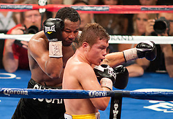 May 5, 2012: WBC super welterweight world champion Saul Canelo Alvarez (40-0-1, 29 KOs) pounded out a twelve round unanimous decision over former multi-division world champion Sugar Shane Mosley (46-8-1, 39 KOs). Canelo was cut over the left eye by a head clash in round three, but the fight was never in doubt. Alvarez was generally too strong for Mosley as he battered the game 40-year-old for the full twelve rounds. Scores were 119-109, 118-110, 119-109....