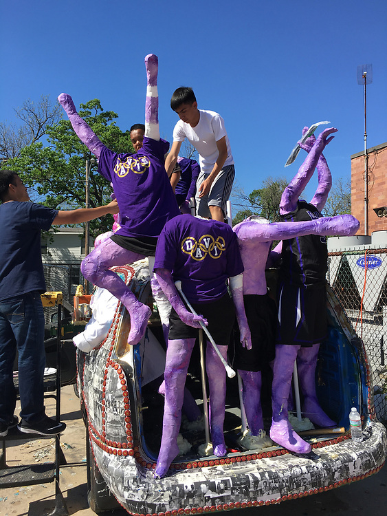 Students create Northside High School's art car, which includes mannequins wearing school T-shirts.
