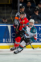 KELOWNA, CANADA - MARCH 3: Brendan De Jong #21 of the Portland Winterhawks back checks Liam Kindree #26 of the Kelowna Rockets  on March 3, 2019 at Prospera Place in Kelowna, British Columbia, Canada.  (Photo by Marissa Baecker/Shoot the Breeze)