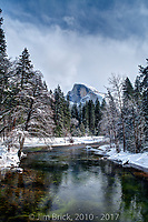 Half Dome from Sentinel Bridge during freezing winter weather.