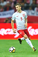 Warsaw, Poland - 2017 September 04: Krzysztof Maczynski from Poland controls the ball during soccer match Poland v Kazakhstan - FIFA 2018 World Cup Qualifier at PGE National Stadium on September 04, 2017 in Warsaw, Poland.<br /> <br /> Adam Nurkiewicz declares that he has no rights to the image of people at the photographs of his authorship.<br /> <br /> Picture also available in RAW (NEF) or TIFF format on special request.<br /> <br /> Any editorial, commercial or promotional use requires written permission from the author of image.<br /> <br /> Mandatory credit:<br /> Photo by © Adam Nurkiewicz / Mediasport