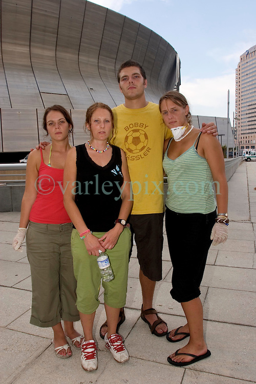 31st August, 2005. New Orleans, Louisiana.<br /> British tourists L/R; Sarah Yorston, Jamie Trout, Jane Whaeldon and Marisa Haigh outside the Superdome in New Orleans, Louisiana where over 20,000 refugees from hurricane Katrina are crammed into hellish conditions.Tourists were pulled out of the hell that is the Superdome after they received increasing threats.<br /> Photo Credit: Charlie Varley/varleypix.com