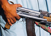 Pakistan, Sehwan Sharif, 2004. A young man's deadly pride and joy in the Sindhi desert. Guns are a fact of life this far from government eyes.
