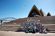 Sydney Opera House, Harbour Bridge. School class taking souvenir photo.