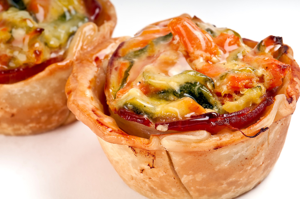 Homemade mini quiches of vegetables close up