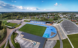 Tehvandi sport center in Otepää, Estonia. Aerial view, stadium and bleachers. Parking lot.