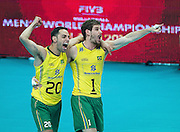 Brazil's Oliveira Raphael De Vieira (left) Bruno Mossa Rezende (right) celebrate after winnig the match between France and Brazil during the 2014 FIVB Volleyball World Championships at Spodek in Katowice on September 20, 2014.