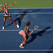 Serena Williams, USA, (right) and Venus Williams, USA, in action in the late afternoon light on Louis Armstrong Stadium against Anastasia Pavlyuchenkova, Russia and Lucie Safarova, Czech Republic, in the Women's Doubles, Round 3 match at the US Open. Flushing. New York, USA. 4th September 2013. Photo Tim Clayton