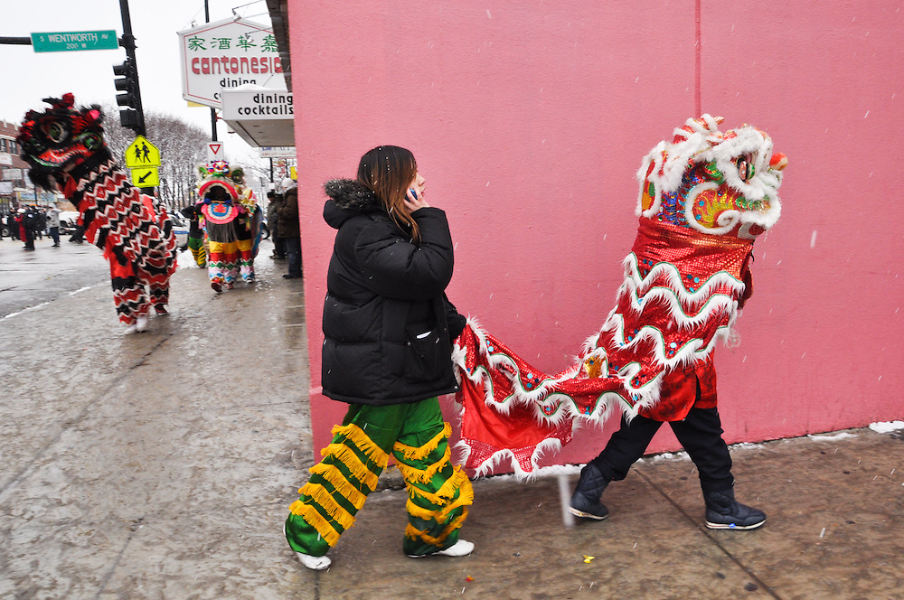 Lion dancers punch out. Chinese New Year, Chinatown, Chicago, February 6th, 2011
