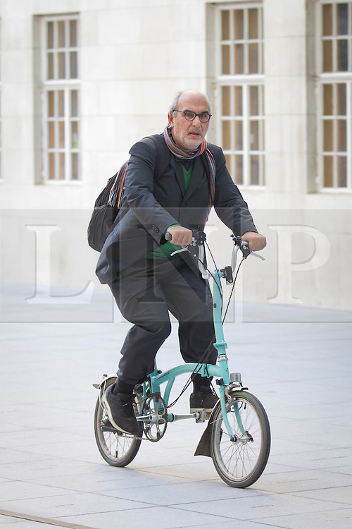 © Licensed to London News Pictures. 02/04/13. London, UK. British Broadcasting Corporation creative director Alan Yentob is seen cycling, without a helmet, across the forecourt of BBC Broadcasting house in London. Photo credit: Matt Cetti-Roberts/LNP