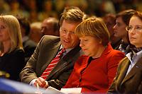 12 JAN 2003, BRAUNSCHWEIG/GERMANY:<br /> Christian Wulff (Mi-L), CDU Landesvorsitzender Niedersachsen, und Angela Merkel (Mi-R), CDU Bundesvorsitzende, im Gespraech, Wahlkampfauftakt der CDU Niedersachsen zur Landtagswahl, Volkswagenhalle<br /> IMAGE: 20030112-01-020<br /> KEYWORDS: Spitzenkandidat, Gespr&auml;ch