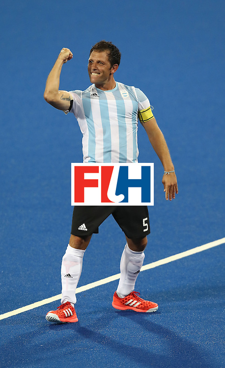 RIO DE JANEIRO, BRAZIL - AUGUST 18: Pedro Ibarra, the captain of Argentina celebrates their 4-2 victory to win the gold medal during the Men's Gold Medal match between Argentina and Belgium on Day 13 of the Rio 2016 Olympic Games held at the Olympic Hockey Centre on August 18, 2016 in Rio de Janeiro, Brazil.  (Photo by David Rogers/Getty Images)