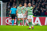 Scott Brown (#8) of Celtic FC shows his anger towards one of the RB Salzburg players after a tackle on Ryan Christie (#17) of Celtic FC during the UEFA Europa League Group B match between Celtic FC and RB Salzburg at Celtic Park, Glasgow, Scotland on 13 December 2018.