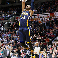 02 December 2013: Indiana Pacers small forward Paul George (24) goes for the dunk during the Portland Trail Blazers 106-102 victory over the Indiana Pacers at the Moda Center, Portland, Oregon, USA.