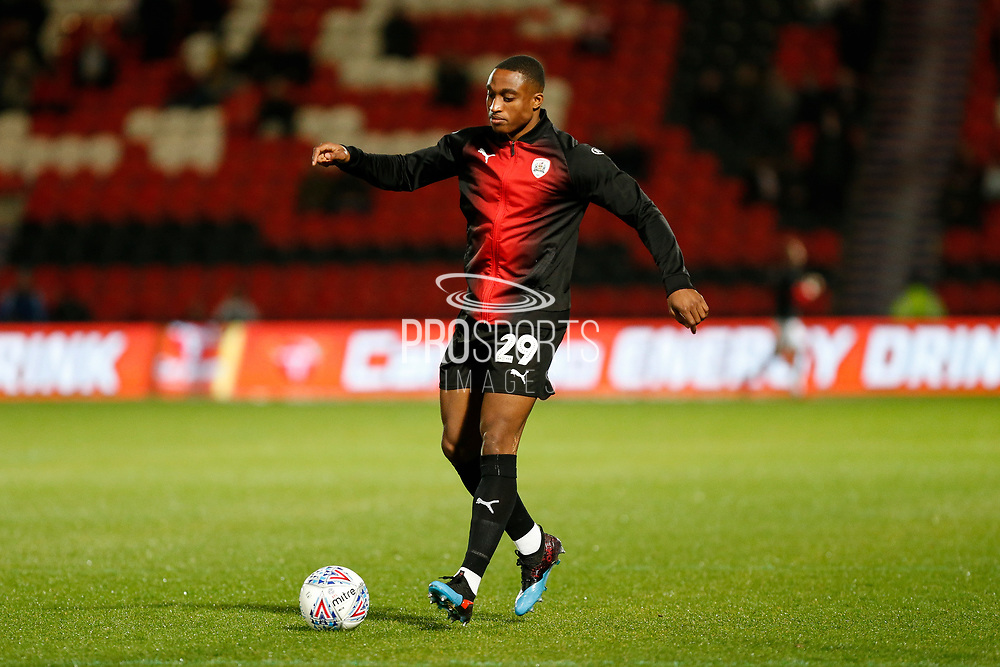 Victor Adeboyejo of Barnsley F.C. warms up for the EFL Sky Bet League 1 match between Doncaster Rovers and Barnsley at the Keepmoat Stadium, Doncaster, England on 15 March 2019.