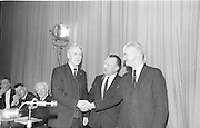 Mr Seamus Ryan (left) Chairman Munster Council GAA being congratulated by the outgoing President Dr Alf Murray, on his election as new President. Centre is Mr Sean O'Siochain, Ard Runai...Annual Congress, GAA. 26.3.1967. 26th March 1967