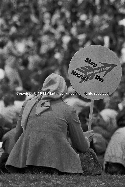 Woman with Anti Nazi League placard at the final Rock Against Racism Festival. Roundhay Park Leeds 04-07-1981.