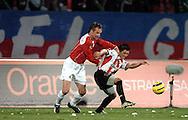 n/z.: Maciej Stolarczyk (nr3-Wisla), Tomasz Moskala (nr18-Cracovia) podczas meczu ligowego Wisla Krakow (czerwone) Cracovia Krakow (czerwone-biale) 3:0 , I liga polska , 4 kolejka sezon 2005/2006 , pilka nozna , Polska , Krakow , 22-11-2005 , fot.: Adam Nurkiewicz / mediasport..Maciej Stolarczyk (nr3-Wisla), Tomasz Moskala (nr18-Cracovia) fight for the ball during Polish league first division soccer match in Cracow. November 22, 2005 ; Wisla Krakow (red) - Cracovia Krakow (red-white) 3:0 ; 4 round season 2005/2006 , football , Poland , Cracow ( Photo by Adam Nurkiewicz / mediasport )