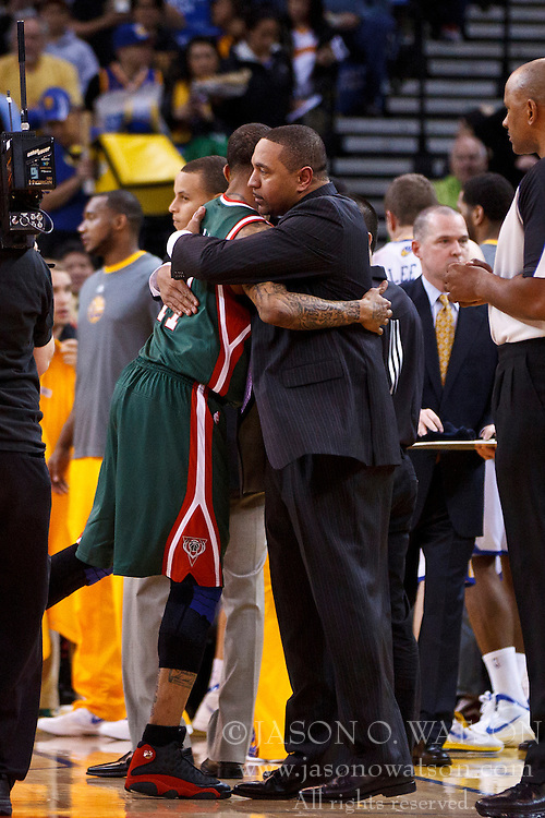 Mar 16, 2012; Oakland, CA, USA; Milwaukee Bucks point guard Monta Ellis (left) hugs Golden State Warriors head coach Mark Jackson (right) before the game at Oracle Arena. Mandatory Credit: Jason O. Watson-US PRESSWIRE