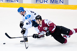 Mika Pyorala of Finland vs Kaspars Saulietis of Latvia during ice-hockey match between Latvia and Finland of Group D of IIHF 2011 World Championship Slovakia, on May 2, 2011 in Orange Arena, Bratislava, Slovakia. (Photo by Matic Klansek Velej / Sportida)