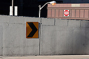 Posts, railings, walls, and street signs form a graphic composition somewhere near the Lincoln Tunnel in Manhattan.