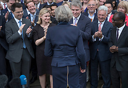 © Licensed to London News Pictures. 11/07/2016. London, UK. Home Secretary Theresa May faces fellow MPs outside Parliament after becoming leader of the Conservative Party . Mrs May will become Prime Minister on Wednesday after Andrea Leadsom stood down earlier today. Photo credit: Peter Macdiarmid/LNP