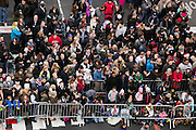 Crowds gather on 6th Avenue to view the 89th annual Macy's Thanksgiving Day Parade as seen from above street level on Thursday, Nov. 26, 2015, in New York. (Photo by Ben Hider/Invision/AP)