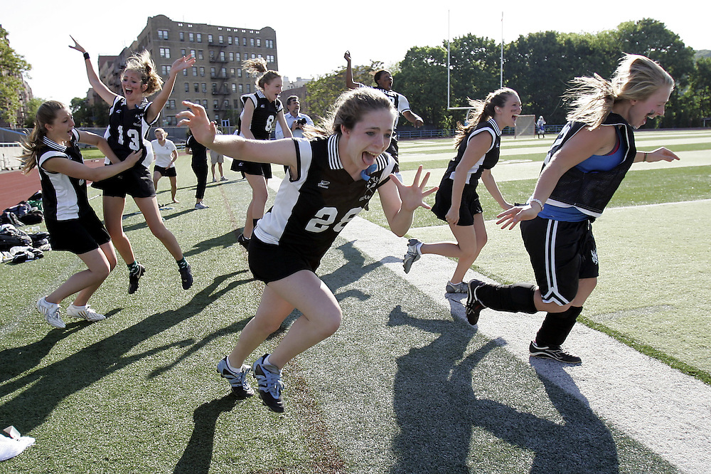 New York, NY / 2009 - Hackley players rush the field after winning the NYSAIS championship game between Hackley and Portledge 10-9 at the Baker Athletic Complex at Columbia University May 20, 2009. ( Mike Roy / The Journal News )