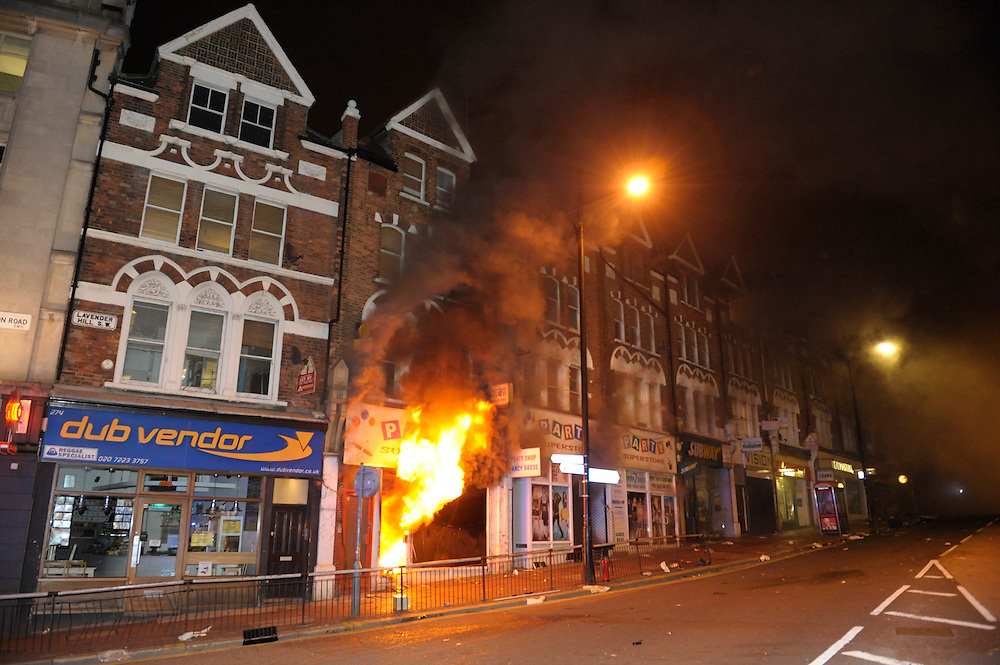 Party Superstore set alight by rioters during a night of rioting at Clapham junction South London