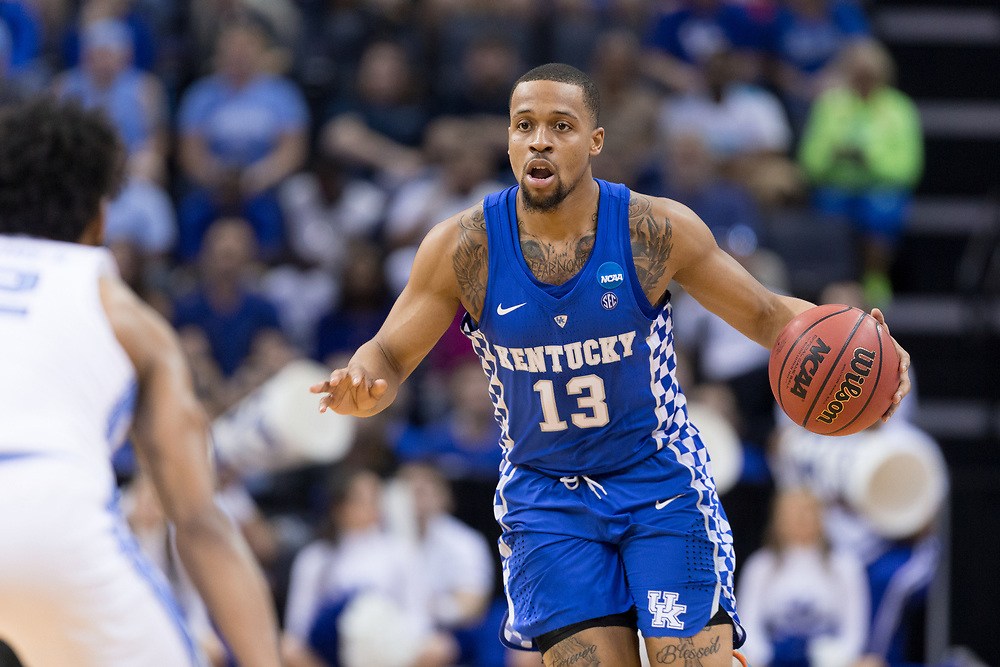 Kentucky guard Isaiah Briscoe brings the ball up the floor in the first half. <br /> <br /> The University of Kentucky hosted the University of North Carolina in a 2017 NCAA D1 Men's South Regional Championship, Sunday, March 26, 2017 at FedExForum in Memphis.