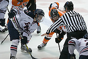 RIT forward Todd Skirving and Robert Morris forward Spencer Dorowicz take a face-off during the Atlantic Hockey final at the Blue Cross Arena in Rochester on Saturday, March 19, 2016.