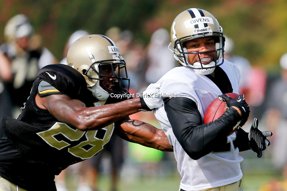 Aug 3, 2013; Metairie, LA, USA; New Orleans Saints cornerback Keenan Lewis (28) tackles wide receiver Chris Givens (17) during a scrimmage at the team training facility. Mandatory Credit: Derick E. Hingle-USA TODAY Sports