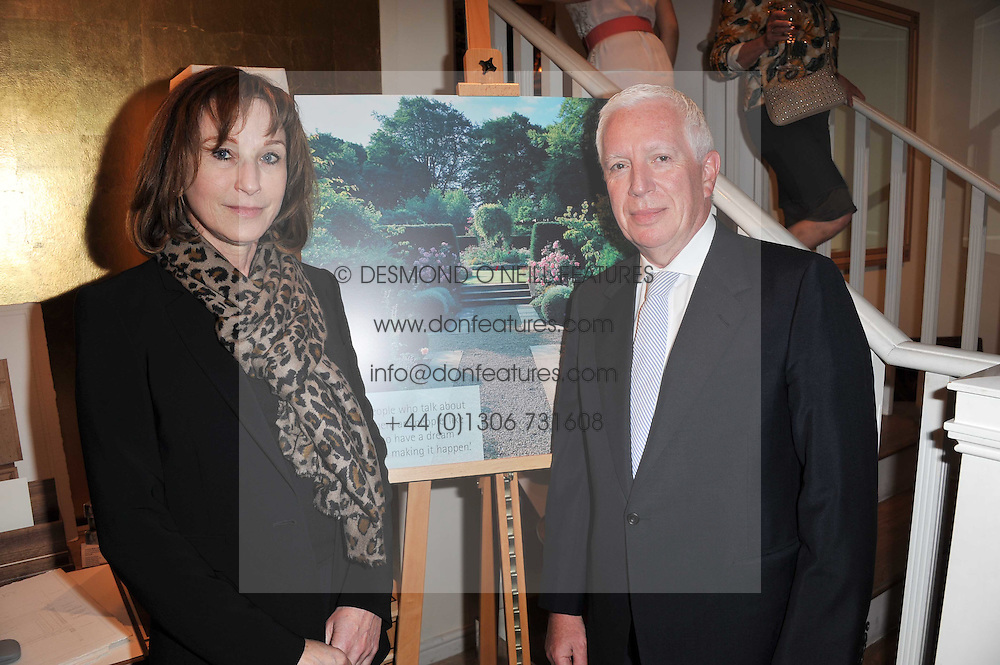 BARRY & LAURA TOWNSLEY at a party to celebrate the publication of 'Garden' by Randle Siddeley held at Linley, 60 Pimlico Road, London on 24th May 2011.