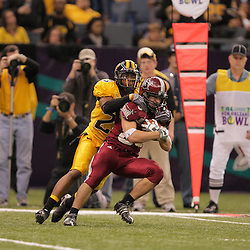 21 December 2008:  Southern Miss running back Kameron Roan (20) tackles Troy wide receiver Zack Marcum (83) during a 30-27 overtime victory by the Southern Mississippi Golden Eagles over the Troy Trojans in the  R+L Carriers New Orleans Bowl at the New Orleans Superdome in New Orleans, LA.