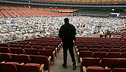 HOUSTON - SEPTEMBER 4: An evacuees surveys the floor of the Reliant Astrodome, Sunday, Sept. 4, 2005. There are currently about 16,000 evacuees staying in the shelter. .<br />