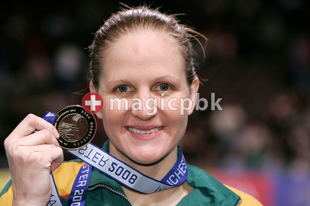 Kirsty COVENTRY of Zimbabwe poses with her gold medal after winning in a new world record time the women's 200m individual medley (IM) final in the Duncan Goodhew pool at the 9th FINA Swimming World Championships (25m) in Manchester, Great Britain, Saturday, April 12, 2008. (Photo by Patrick B. Kraemer / MAGICPBK)