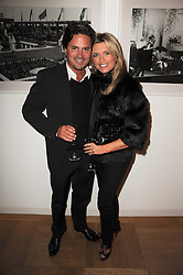 OLIVER WHEELER and TINA HOBLEY at a party to celebrate the launch of 'Interiors by Yoo' - a book by John Hitchcox, Philippe Starck, Kelly Hoppen, Jade Jagger and Marcel Wanders held at Selfridges, 400 Oxford Street, London on 3rd December 2009.