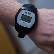 ROCKVILLE, MD - JUL25: John Bucknam, 18, who has autism, wears a GPS watch so his location is always known in case he wanders away from home, July 25, 2014. The Bucknam's have a series of locks on their doors to keep John from wandering off. (Photo by Evelyn Hockstein/For The Washington Post)