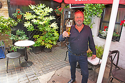 ©Licensed to London News Pictures 03/07/2020     <br /> Chislehurst, UK. Landlord Alan Weeks in the courtyard. The Imperial Arms pub and courtyard bistro in Chislehurst, South East London is preparing to open its doors again after three months of coronavirus lockdown.  Photo credit: Grant Falvey/LNP