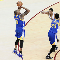 10 June 2016: Golden State Warriors forward Andre Iguodala (9) takes a jump shot over Cleveland Cavaliers forward Channing Frye (9) on a screen set by Golden State Warriors guard Shaun Livingston (34) during the Golden State Warriors 108-97 victory over the Cleveland Cavaliers, during Game Four of the 2016 NBA Finals at the Quicken Loans Arena, Cleveland, Ohio, USA.